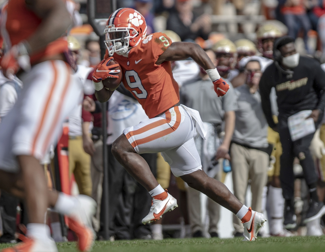 Oct 31, 2020; Clemson, SC, USA; Clemson running back Travis Etienne (9) scores during the first quarter of the game against Boston College at Memorial Stadium. Mandatory Credit: Josh Morgan-USA TODAY Sports