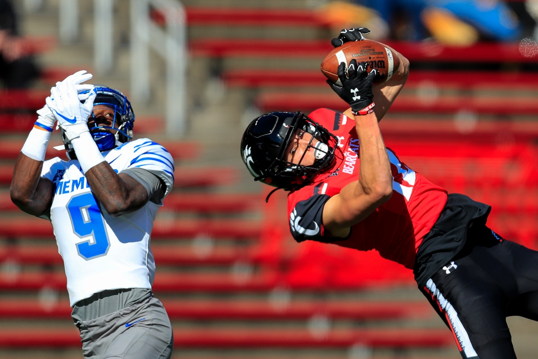 Oct 31, 2020; Cincinnati, Ohio, USA; Memphis Tigers defensive back John Broussard Jr. (9) reacts as Cincinnati Bearcats wide receiver Alec Pierce (12) catches a pass for a touchdown in the first half at Nippert Stadium. Mandatory Credit: Aaron Doster-USA TODAY Sports
