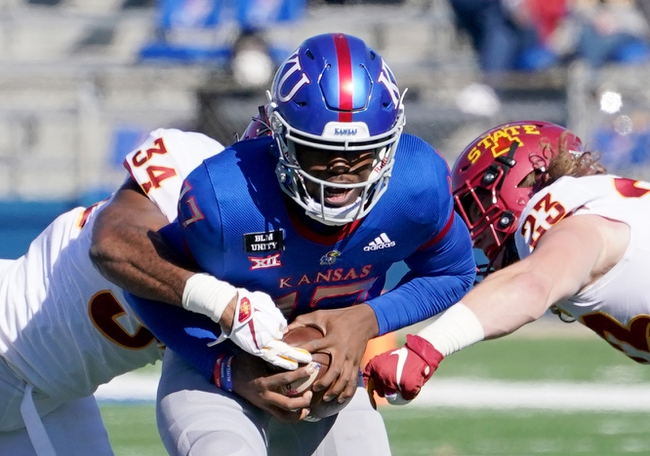 Oct 31, 2020; Lawrence, Kansas, USA; Kansas Jayhawks quarterback Jalon Daniels (17) is sacked by Iowa State Cyclones linebacker O'Rien Vance (34) and linebacker Mike Rose (23) during the first half at David Booth Kansas Memorial Stadium. Mandatory Credit: Denny Medley-USA TODAY Sports