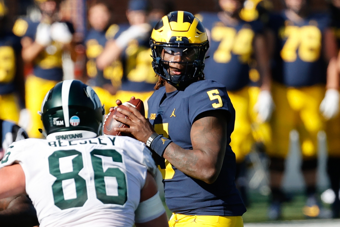 Oct 31, 2020; Ann Arbor, Michigan, USA;  Michigan Wolverines quarterback Joe Milton (5) looks to pass in the second half against the Michigan State Spartans at Michigan Stadium. Mandatory Credit: Rick Osentoski-USA TODAY Sports