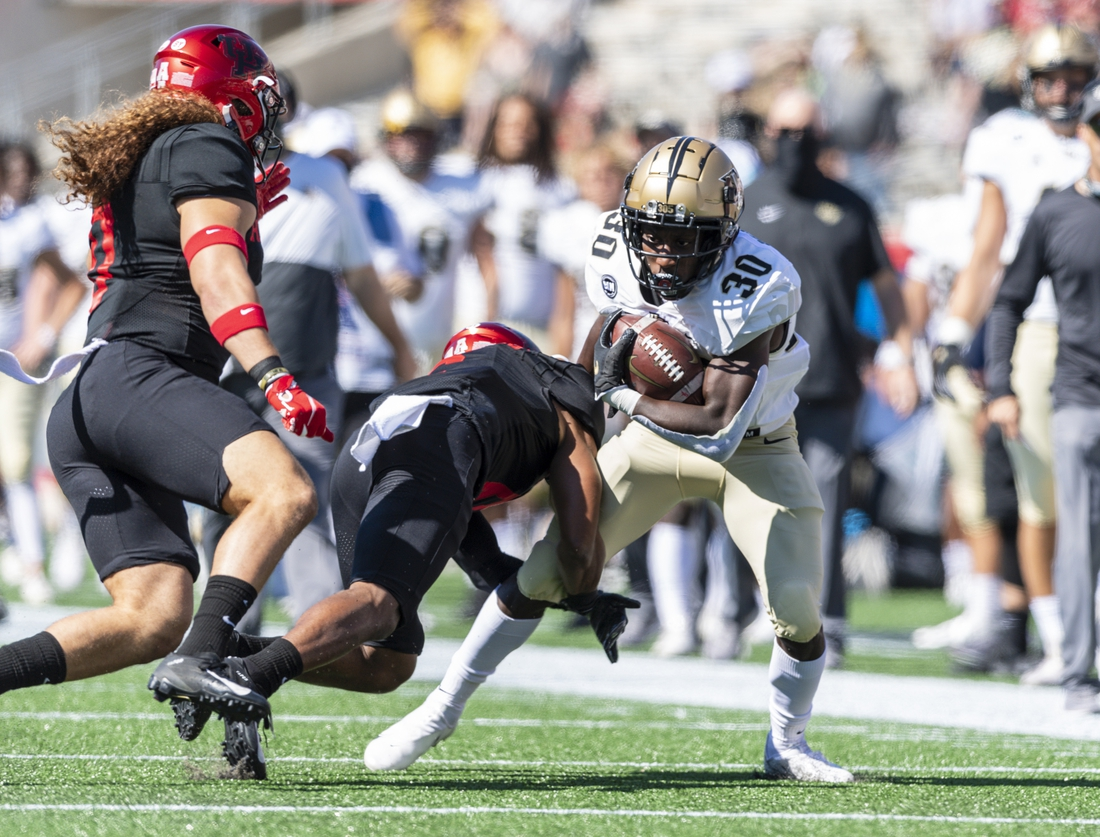 Oct 31, 2020; Houston, Texas, USA; Houston Cougars cornerback Damarion Williams (6) tackles UCF Knights running back Greg McCrae (30) during the first quarter at TDECU Stadium. Mandatory Credit: Maria Lysaker-USA TODAY Sports
