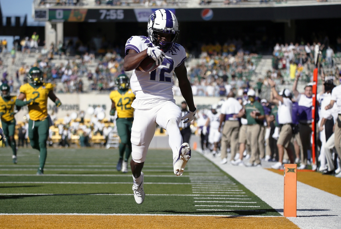Oct 31, 2020; Waco, Texas, USA; TCU Horned Frogs wide receiver Derius Davis (12) heads for the end zone on a 66-yard punt return for touchdown during the first half at McLane Stadium. Mandatory Credit: Raymond Carlin III-USA TODAY Sports