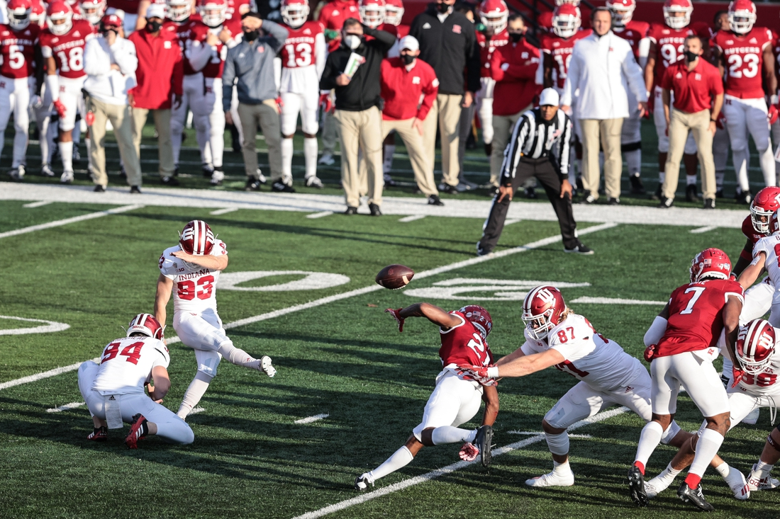 Oct 31, 2020; Piscataway, New Jersey, USA; Indiana Hoosiers place kicker Charles Campbell (93) kicks a field goal held by punter Haydon Whitehead (94) during the first half as Rutgers Scarlet Knights defensive back Tre Avery (21) defends at SHI Stadium. Mandatory Credit: Vincent Carchietta-USA TODAY Sports
