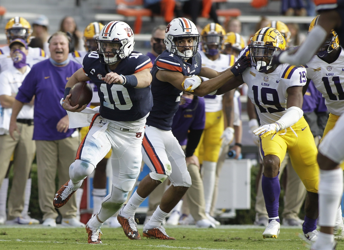 Oct 31, 2020; Auburn, Alabama, USA;  Auburn Tigers quarterback Bo Nix (10) carries against the LSU Tigers during the second quarter at Jordan-Hare Stadium. Mandatory Credit: John Reed-USA TODAY Sports