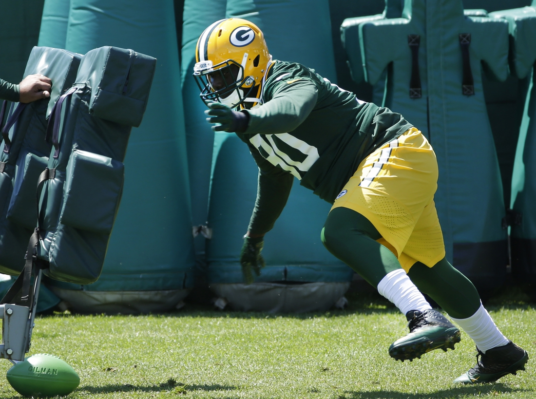 June 1, 2016; Green Bay, WI, USA; Green Bay Packers defensive tackle Montravius Adams (90) participates in drills during organized team activities. Mandatory Credit: Mark Hoffman/Milwaukee Journal Sentinel via USA TODAY NETWORK