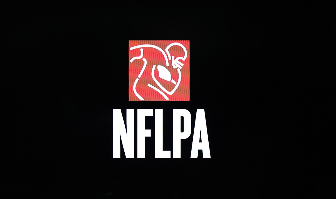 Feb 1, 2018; Bloomington, MN, USA; A detailed view of NFLPA  logo during a press conference in advance of Super Bowl LII between the New England Patriots and Philadelphia Eagles at Mall of America. Mandatory Credit: Matthew Emmons-USA TODAY Sports