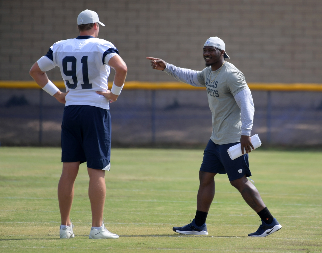 Aug 17, 2018; Oxnard, CA, USA: Dallas Cowboys strength and conditioning coach Markus Paul (right) talks with long snapper Louis-Philippe Ladouceur (91) during training camp at River Ridge Fields. Mandatory Credit: Kirby Lee-USA TODAY Sports