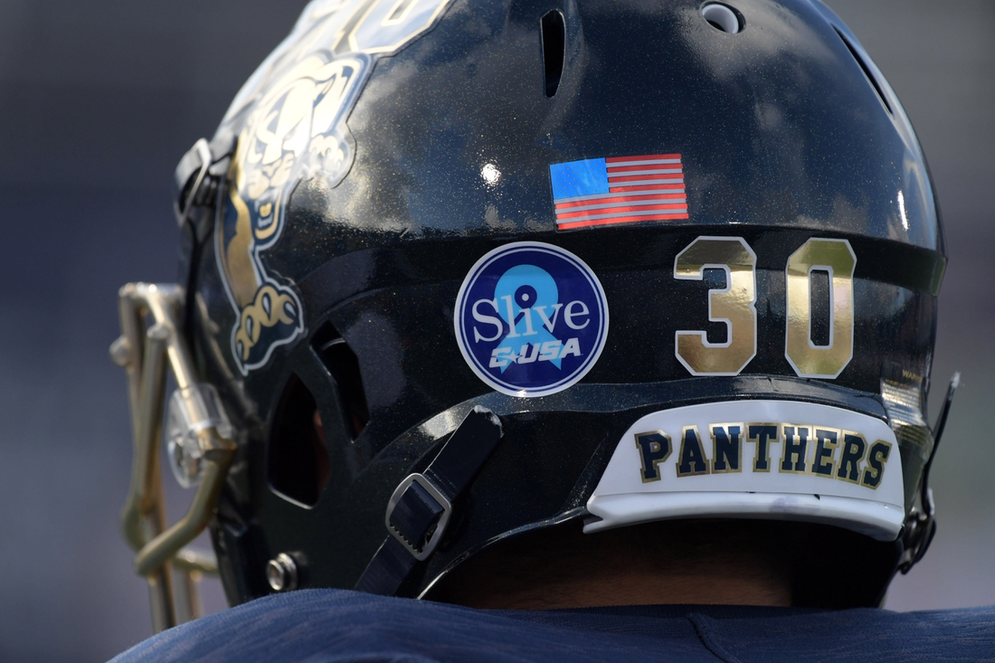 Sep 1, 2018; Miami, FL, USA;  FIU Golden Panthers place kicker Jose Borregales (30) wears a decal on back of helmet to honor Conference USA commissioner Mike Slive, who passed away in May 2018 at the age of 77 of prostate cancer, during the game against the FIU Golden Panthers  at Riccardo Silva Stadium. Mandatory Credit: Kirby Lee-USA TODAY Sports