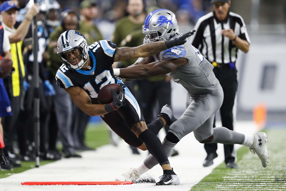 Nov 18, 2018; Detroit, MI, USA; Carolina Panthers wide receiver DJ Moore (12) gets pushed out of bounds by Detroit Lions defensive back Tavon Wilson (32) during the fourth quarter at Ford Field. Mandatory Credit: Raj Mehta-USA TODAY Sports