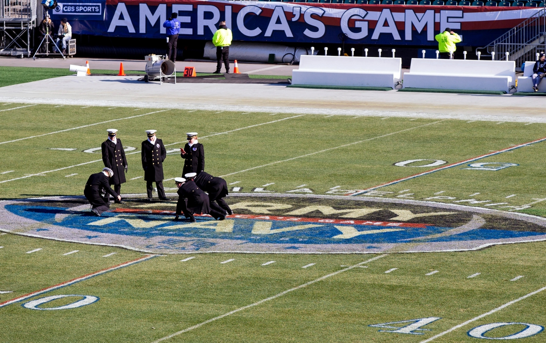 Dec 8, 2018; Philadelphia, PA, USA; Navy Midshipmen pose for photos on the center field logo at Lincoln Financial Field before the game against the Army Black Knights. Mandatory Credit: Bill Streicher-USA TODAY Sports