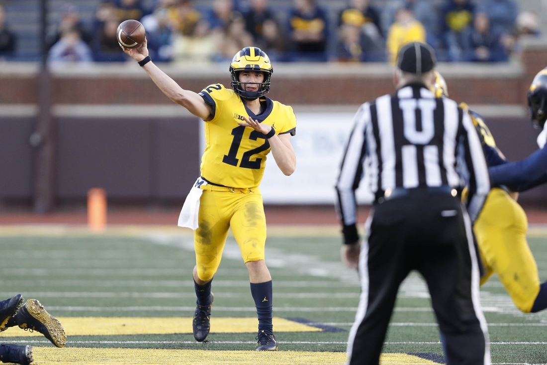 Apr 13, 2019; Ann Arbor, MI, USA; Michigan Wolverines quarterback Cade McNamara (12) passes the ball during the spring football game at Michigan Stadium. Mandatory Credit: Raj Mehta-USA TODAY Sports