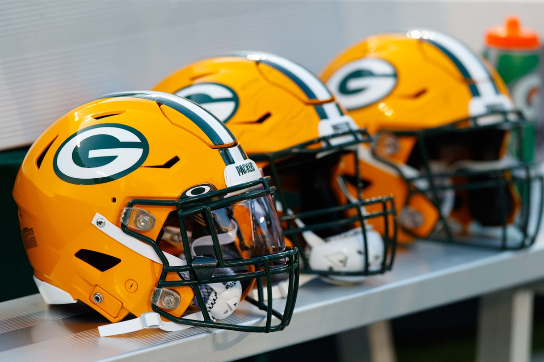 Aug 8, 2019; Green Bay, WI, USA; Green Bay Packers helmets sit on the sidelines during the game against the Houston Texans at Lambeau Field. Mandatory Credit: Jeff Hanisch-USA TODAY Sports