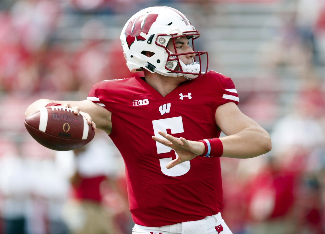 Sep 7, 2019; Madison, WI, USA; Wisconsin Badgers quarterback Graham Mertz (5) throws a pass during warmups prior to the game against the Central Michigan Chippewas at Camp Randall Stadium. Mandatory Credit: Jeff Hanisch-USA TODAY Sports