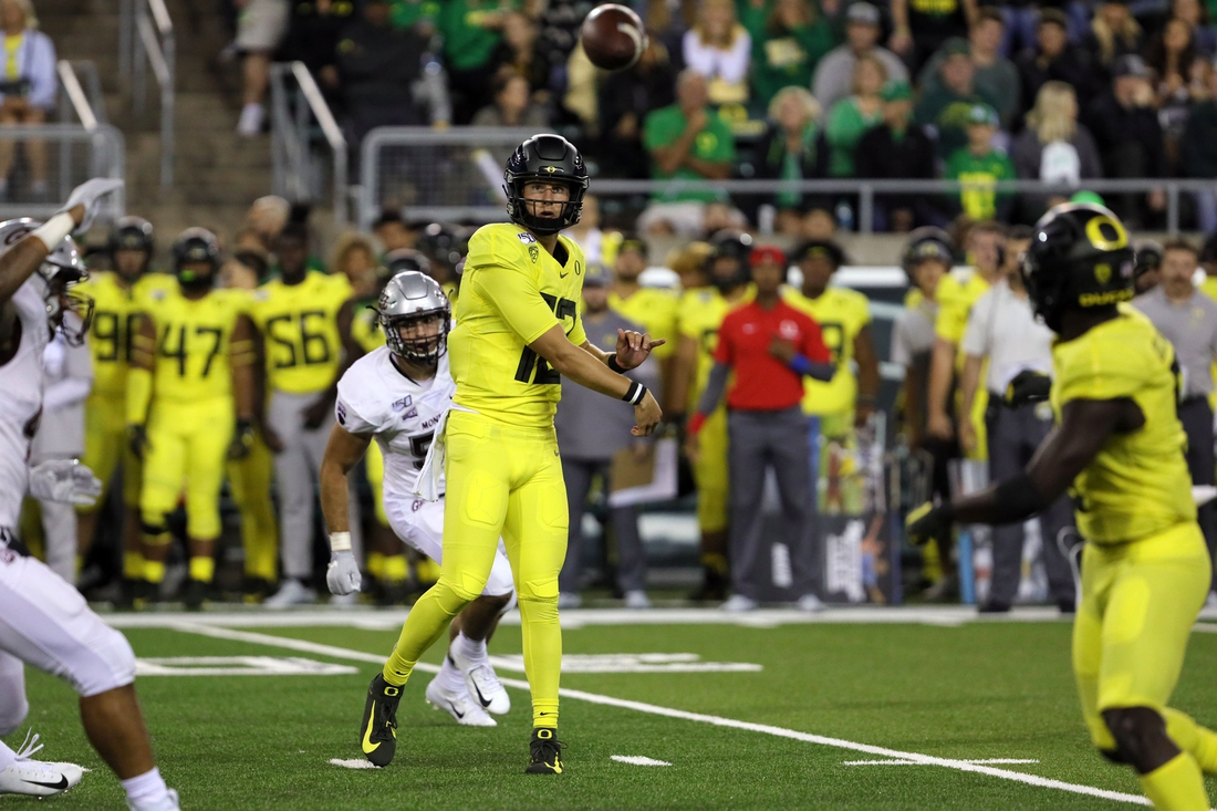 Sep 14, 2019; Eugene, OR, USA; Oregon quarterback Tyler Shough (12) completes a pass against Montana at Autzen Stadium. Mandatory Credit: Rob Kerr-USA TODAY Sports