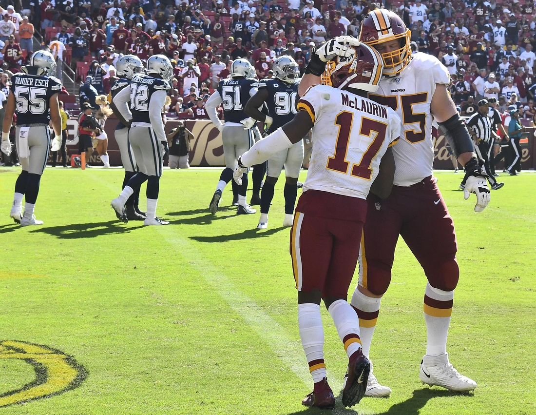 Sep 15, 2019; Landover, MD, USA; Washington Redskins wide receiver Terry McLaurin (17) is congratulated by offensive guard Brandon Scherff (75) after scoring a touchdown against the Dallas Cowboys during the second half at FedExField. Mandatory Credit: Brad Mills-USA TODAY Sports