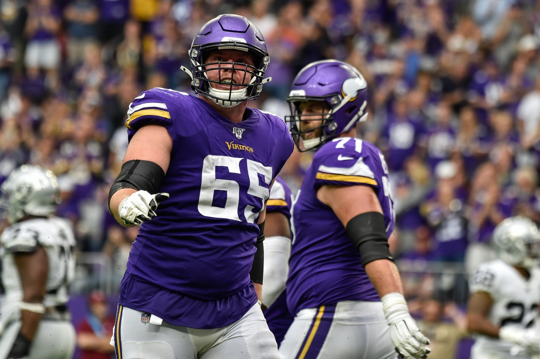 Sep 22, 2019; Minneapolis, MN, USA; Minnesota Vikings offensive guard Pat Elflein (65) in action against the Oakland Raiders at U.S. Bank Stadium. Mandatory Credit: Jeffrey Becker-USA TODAY Sports