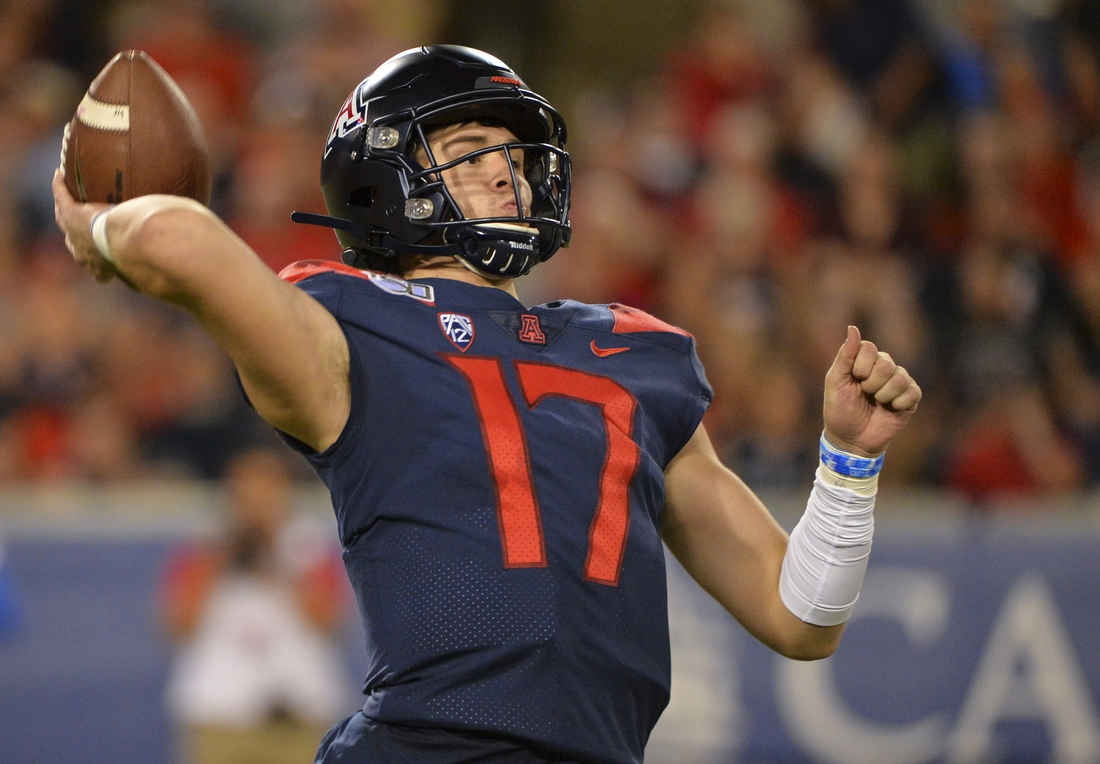 Sep 28, 2019; Tucson, AZ, USA; Arizona Wildcats quarterback Grant Gunnell (17) passes the ball during the second half against the UCLA Bruins at Arizona Stadium. Mandatory Credit: Casey Sapio-USA TODAY Sports