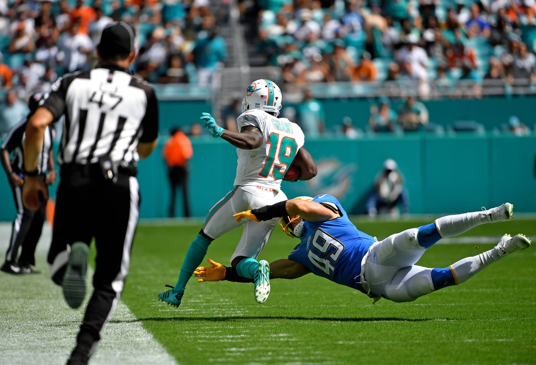 Sep 29, 2019; Miami Gardens, FL, USA; Los Angeles Chargers linebacker Drue Tranquill (49) tackles Miami Dolphins wide receiver Jakeem Grant (19) on a kick off return during the second half at Hard Rock Stadium. Mandatory Credit: Steve Mitchell-USA TODAY Sports
