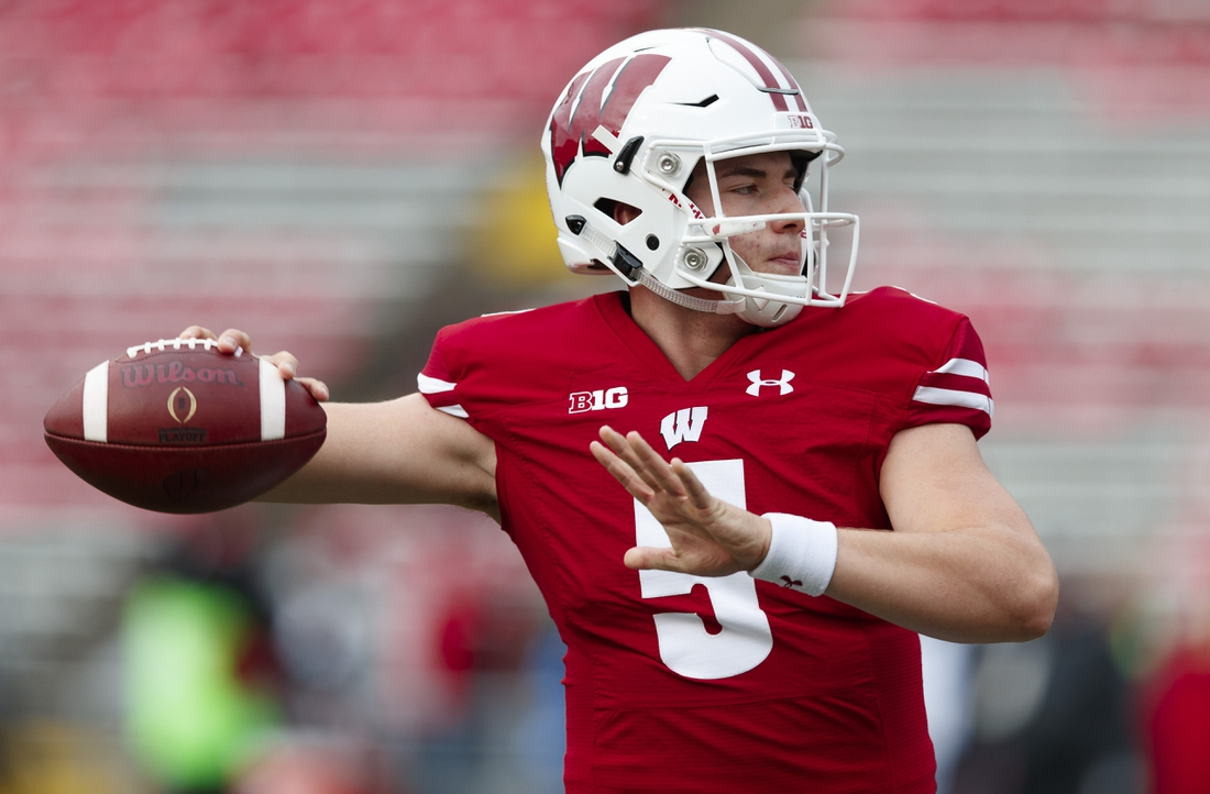 Oct 5, 2019; Madison, WI, USA; Wisconsin Badgers quarterback Graham Mertz (5) throws a pass during warmups prior to the game against the Kent State Golden Flashes at Camp Randall Stadium. Mandatory Credit: Jeff Hanisch-USA TODAY Sports
