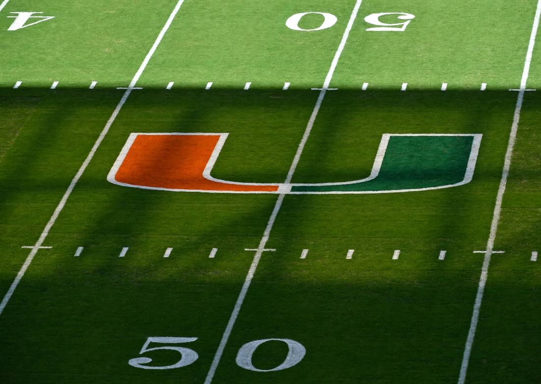Oct 5, 2019; Miami Gardens, FL, USA; A Miami Hurricanes logo is seen on the fifty years line before a game Virginia Tech Hokies at Hard Rock Stadium. Mandatory Credit: Steve Mitchell-USA TODAY Sports