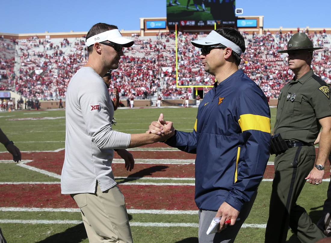 Oct 19, 2019; Norman, OK, USA; Oklahoma Sooners head coach Lincoln Riley (left) greets West Virginia Mountaineers head coach Neal Brown after the game at Gaylord Family - Oklahoma Memorial Stadium. Mandatory Credit: Kevin Jairaj-USA TODAY Sports