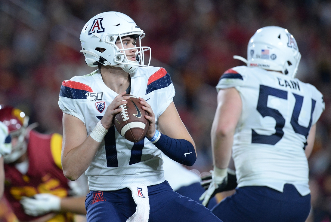 October 19, 2019; Los Angeles, CA, USA; Arizona Wildcats quarterback Grant Gunnell (17) drops back to pass against the Southern California Trojans during the second half at the Los Angeles Memorial Coliseum. Mandatory Credit: Gary A. Vasquez-USA TODAY Sports