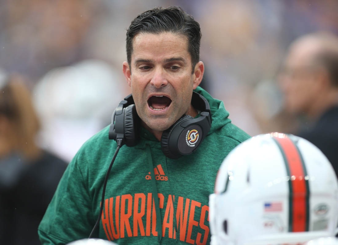 Oct 26, 2019; Pittsburgh, PA, USA;   Miami Hurricanes head coach Manny Diaz reacts on the sidelines against the Pittsburgh Panthers during the second quarter at Heinz Field. Mandatory Credit: Charles LeClaire-USA TODAY Sports