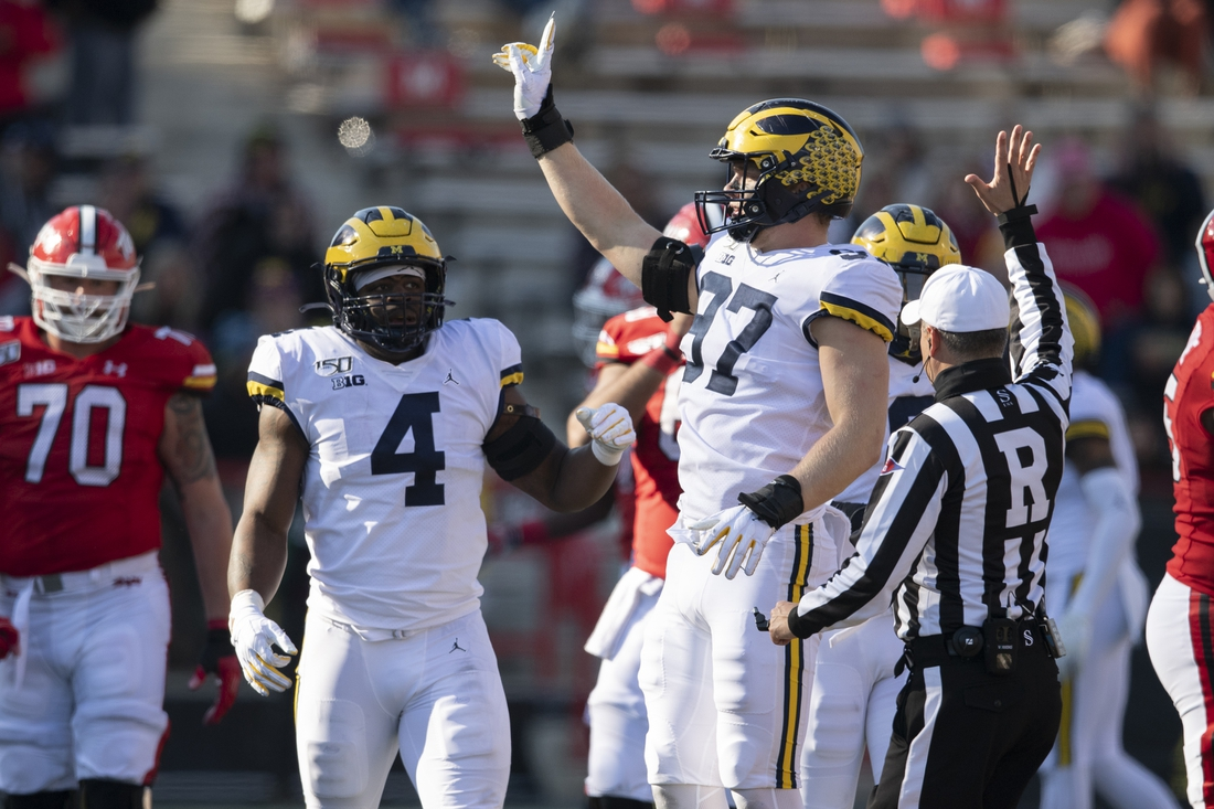 Nov 2, 2019; College Park, MD, USA;  Michigan Wolverines defensive lineman Aidan Hutchinson (97) reacts after sacking Maryland Terrapins quarterback Josh Jackson (not pictured) during the fourth quarter at Capital One Field at Maryland Stadium. Mandatory Credit: Tommy Gilligan-USA TODAY Sports