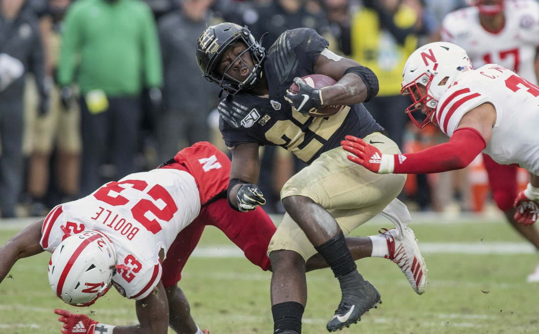 Nov 2, 2019; West Lafayette, IN, USA;  Purdue Boilermakers running back King Doerue (22) is stopped at the line of scrimmage by Nebraska Cornhuskers corner back Dicaprio Bootle (23) at Ross-Ade Stadium. Mandatory Credit: Thomas J. Russo-USA TODAY Sports