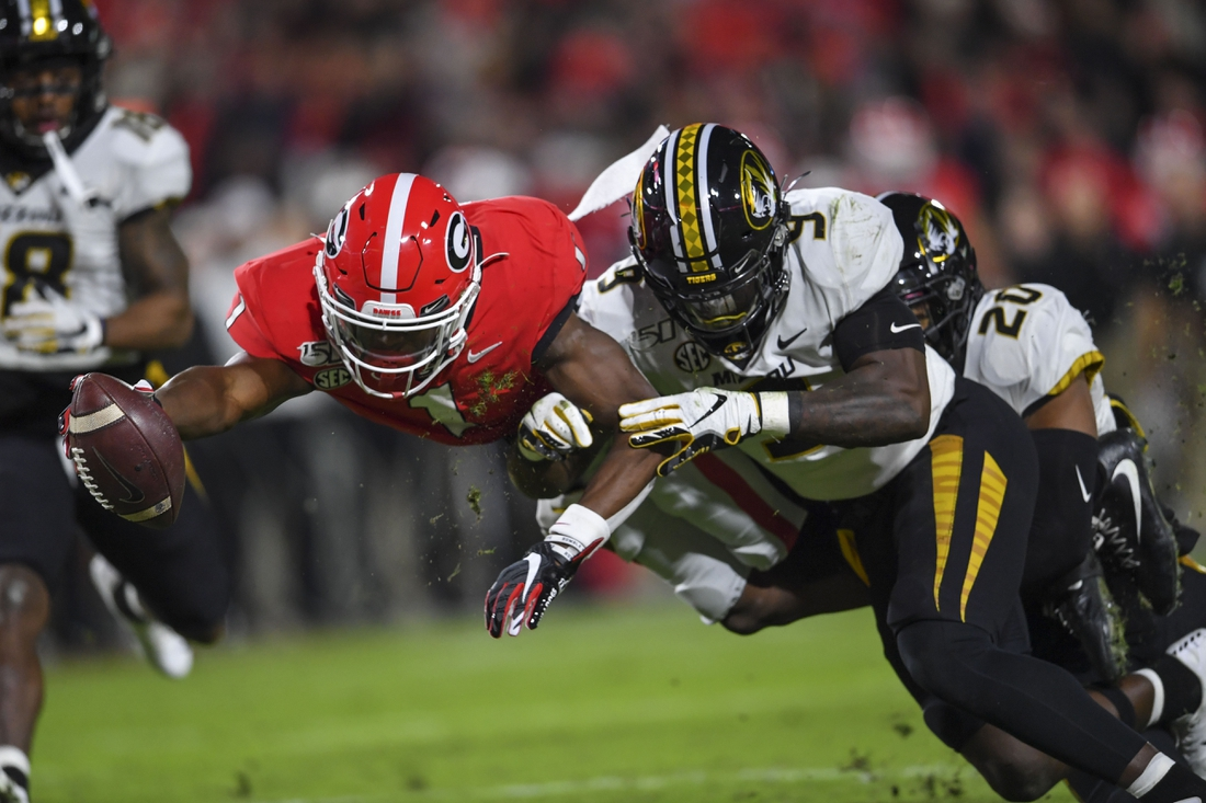 Nov 9, 2019; Athens, GA, USA; Georgia Bulldogs wide receiver George Pickens (1) scores past Missouri Tigers safety Tyree Gillespie (9) during the first half at Sanford Stadium. Mandatory Credit: Dale Zanine-USA TODAY Sports