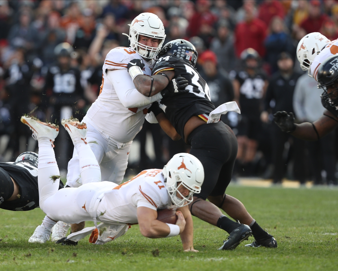 Nov 16, 2019; Ames, IA, USA; Texas Longhorns offensive lineman Parker Braun (73) protects quarterback Sam Ehlinger (11) from Iowa State Cyclones offensive lineman Jarrod Hufford (54) at Jack Trice Stadium. The Cyclones beat the Longhorns 23 to 21.  Mandatory Credit: Reese Strickland-USA TODAY Sports