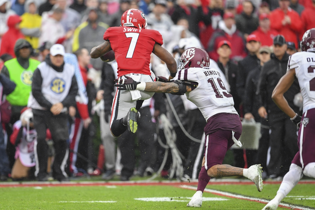 Nov 23, 2019; Athens, GA, USA; Georgia Bulldogs running back D'Andre Swift (7) is tackled by Texas A&M Aggies linebacker Anthony Hines III (19) during the first quarter at Sanford Stadium. Mandatory Credit: Dale Zanine-USA TODAY Sports