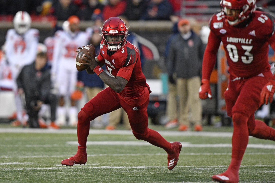 Nov 23, 2019; Louisville, KY, USA; Louisville Cardinals quarterback Micale Cunningham (3) looks to pass against the Syracuse Orange during the second quarter at Cardinal Stadium. Mandatory Credit: Jamie Rhodes-USA TODAY Sports
