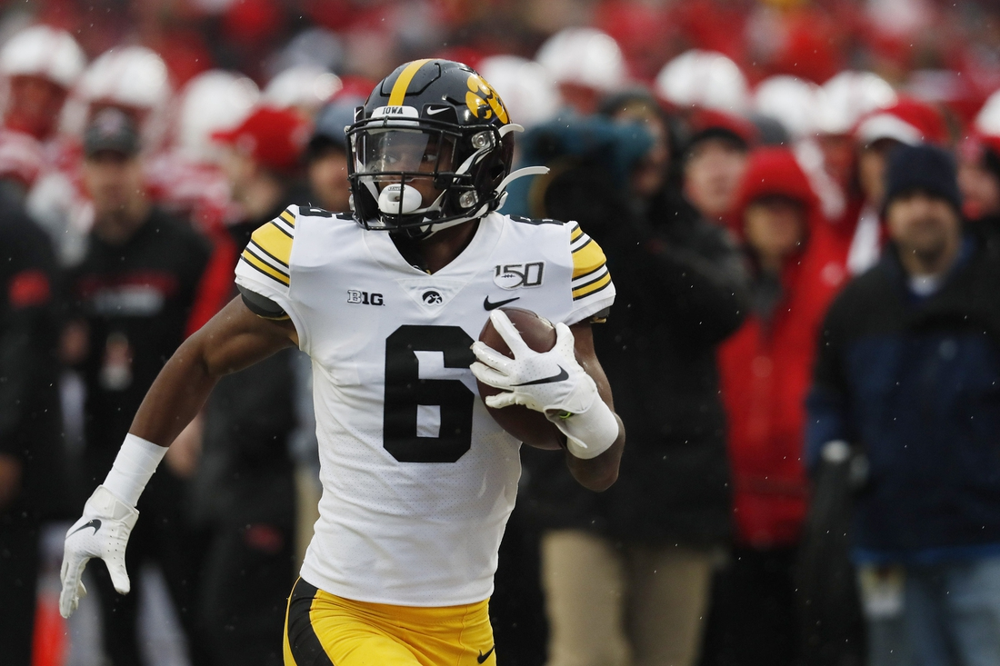 Nov 29, 2019; Lincoln, NE, USA; Iowa Hawkeyes wide receiver Ihmir Smith-Marsette (6) scores a touchdown against the Nebraska Cornhuskers in the first half at Memorial Stadium. Mandatory Credit: Bruce Thorson-USA TODAY Sports