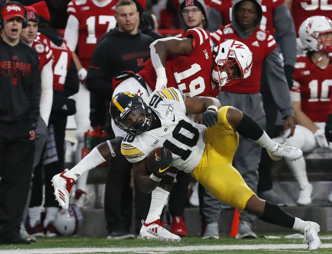 Nov 29, 2019; Lincoln, NE, USA; Nebraska Cornhuskers safety Marquel Dismuke (19) tackles Iowa Hawkeyes running back Mekhi Sargent (10) in the second half at Memorial Stadium. Mandatory Credit: Bruce Thorson-USA TODAY Sports