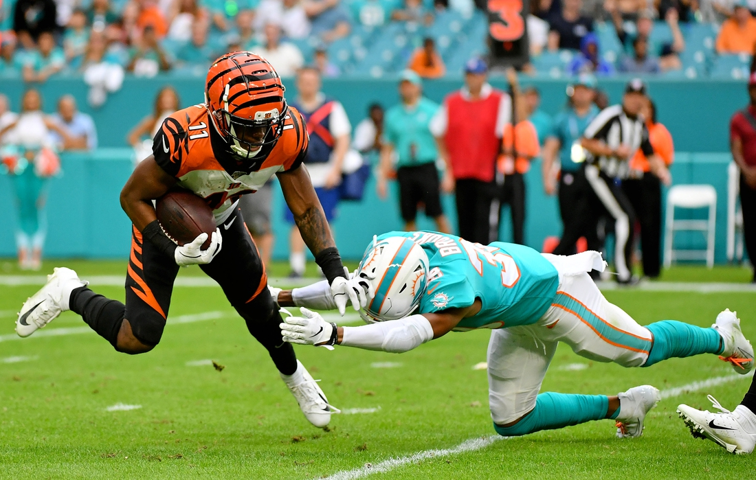 Dec 22, 2019; Miami Gardens, Florida, USA; Miami Dolphins defensive back Nate Brooks (30) attempts to tackle Cincinnati Bengals wide receiver John Ross (11) during overtime at Hard Rock Stadium. Mandatory Credit: Jasen Vinlove-USA TODAY Sports