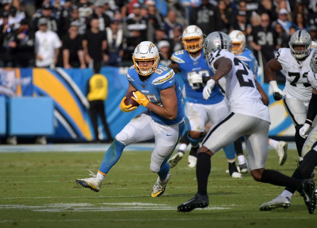 Dec 22, 2019; Carson, California, USA; Los Angeles Chargers tight end Hunter Henry (86) carries the ball in the second quarter against the Oakland Raiders at Dignity Health Sports Park. Mandatory Credit: Kirby Lee-USA TODAY Sports