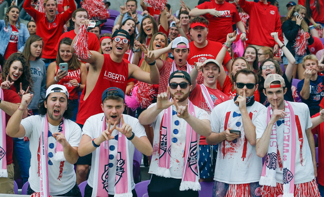 Dec 21, 2019; Orlando, Florida, USA; Liberty Flames fan cheer during the first quarter of the Cure Bowl against the Georgia Southern Eaglesat at Exploria Stadium. Mandatory Credit: Reinhold Matay-USA TODAY Sports