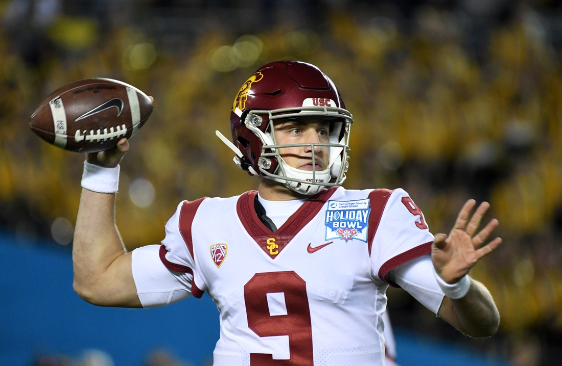 Dec 27, 2019; San Diego, California, USA; Southern California Trojans quarterback Kedon Slovis (9) throws the ball against the Iowa Hawkeyes in the first quarter during the Holiday Bowl at SDCCU Stadium. Mandatory Credit: Kirby Lee-USA TODAY Sports
