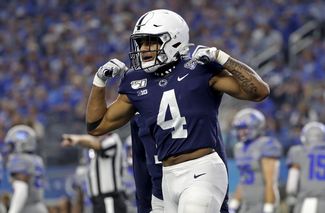 Dec 28, 2019; Arlington, Texas, USA;  Penn State Nittany Lions running back Journey Brown (4) celebrates after running for a touchdown during the second quarter against the Memphis Tigers at AT&T Stadium. Mandatory Credit: Kevin Jairaj-USA TODAY Sports