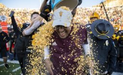 Dec 31, 2019; El Paso, Texas, USA; Arizona State Sun Devils head coach Herm Edwards is doused by Frosted Flakes by his players moments after defeating the Florida State Seminoles 20-14 in the Sun Bowl. Mandatory Credit: Ivan Pierre Aguirre-USA TODAY Sports