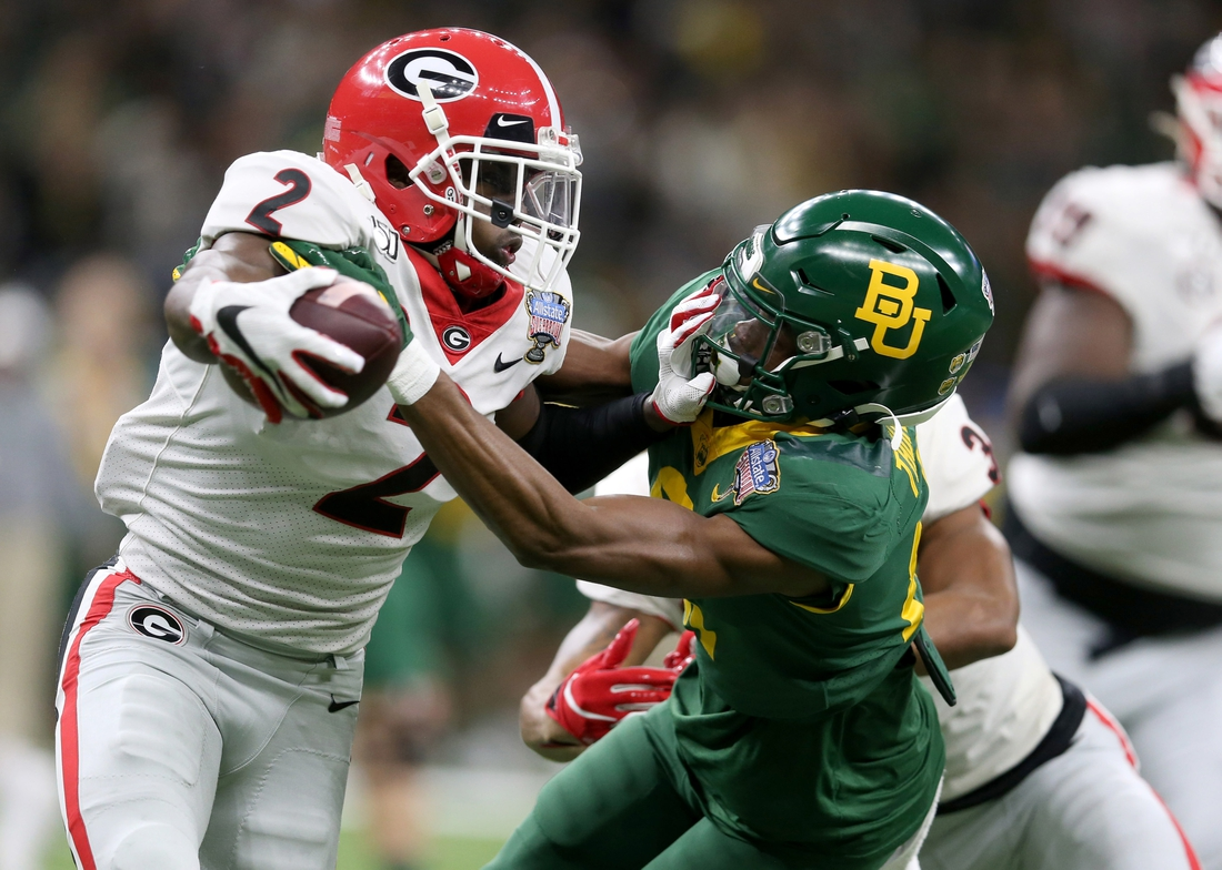 Jan 1, 2020; New Orleans, Louisiana, USA; Georgia Bulldogs defensive back Richard LeCounte (2) is tackled by Baylor Bears wide receiver Tyquan Thornton (81) after an interception in the first quarter at the Sugar Bowl at the Mercedes-Benz Superdome. Mandatory Credit: Chuck Cook-USA TODAY Sports