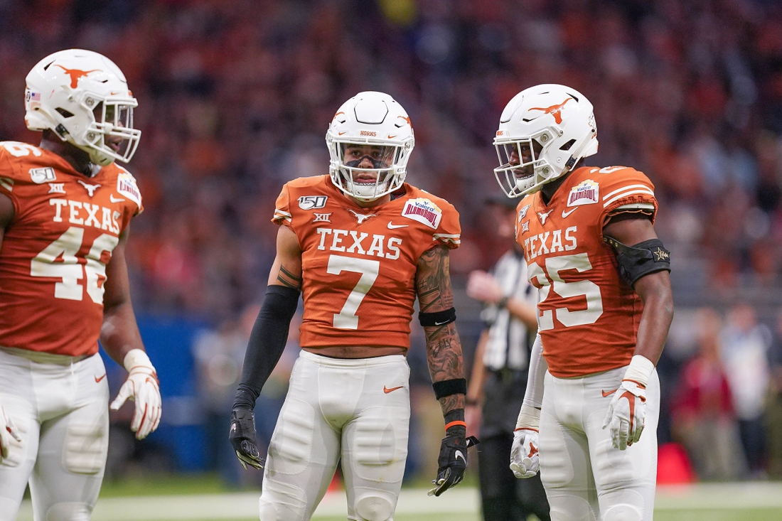 Dec 31, 2019; San Antonio, Texas, USA;  Texas Longhorns linebacker Joseph Ossai (46) and defensive backs Caden Sterns (7) and B.J. Foster (25) in the first half against the Utah Utes at the Alamodome. Mandatory Credit: Daniel Dunn-USA TODAY Sports