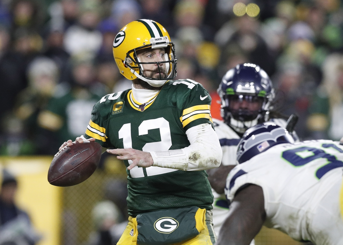 Jan 12, 2020; Green Bay, WI, USA; Green Bay Packers quarterback Aaron Rodgers (12) throws a pass against the Seattle Seahawks in the fourth quarter of a NFC Divisional Round playoff football game at Lambeau Field. Mandatory Credit: Jeff Hanisch-USA TODAY Sports