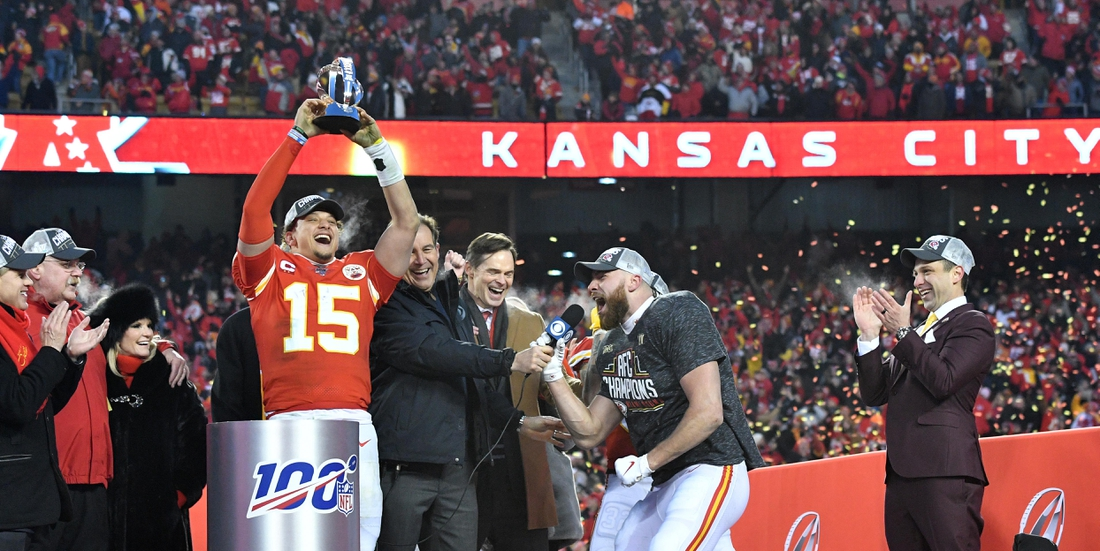 Jan 19, 2020; Kansas City, Missouri, USA; Kansas City Chiefs owner Clark Hunt and head coach Andy Reid and Norma Hunt and Kansas City Chiefs quarterback Patrick Mahomes (15) and CBS sportscaster Jim Nantz  and tight end Travis Kelce (87) and general manager Brett Veach (left to right) celebrate on stage after the AFC Championship Game against the Tennessee Titans at Arrowhead Stadium. Mandatory Credit: Denny Medley-USA TODAY Sports