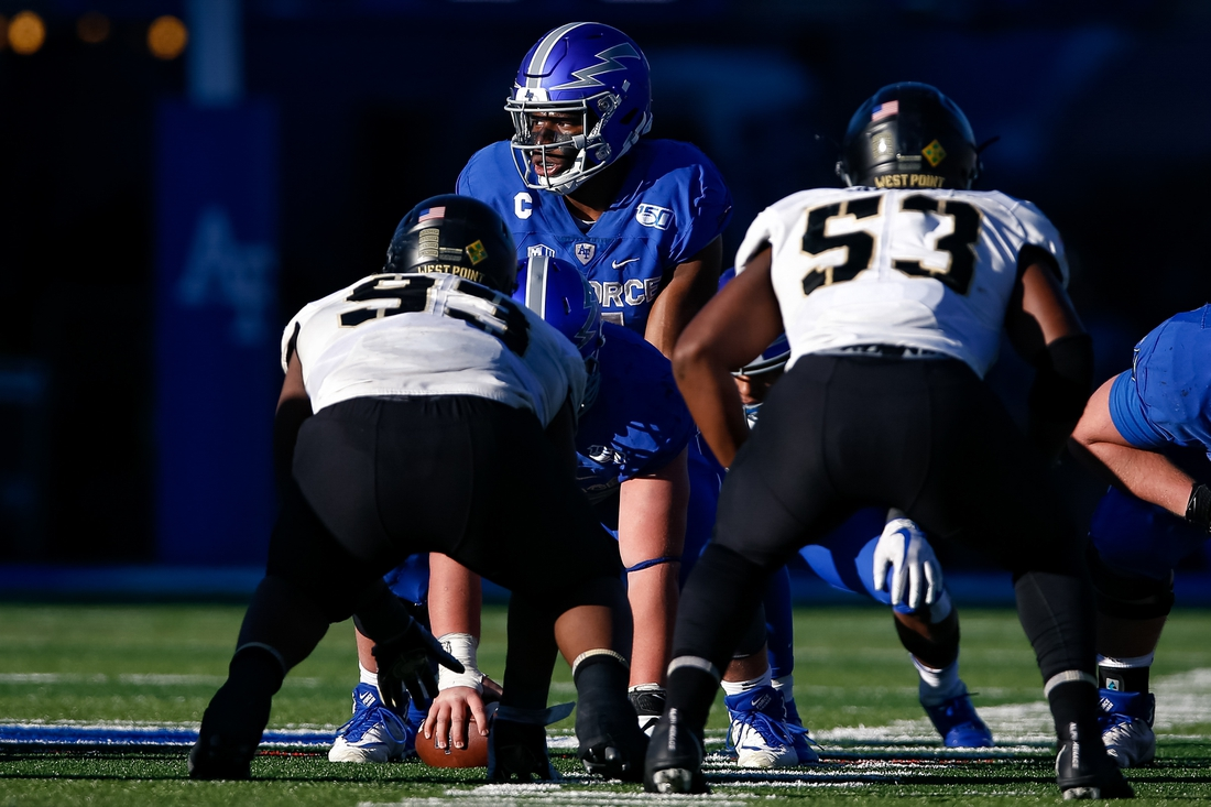 Nov 2, 2019; Colorado Springs, CO, USA; Air Force Falcons quarterback Donald Hammond III (5) at the line of scrimmage against Army Black Knights defensive lineman Rod Stoddard (93) and linebacker Arik Smith (53) in the fourth quarter at Falcon Stadium. Mandatory Credit: Isaiah J. Downing-USA TODAY Sports