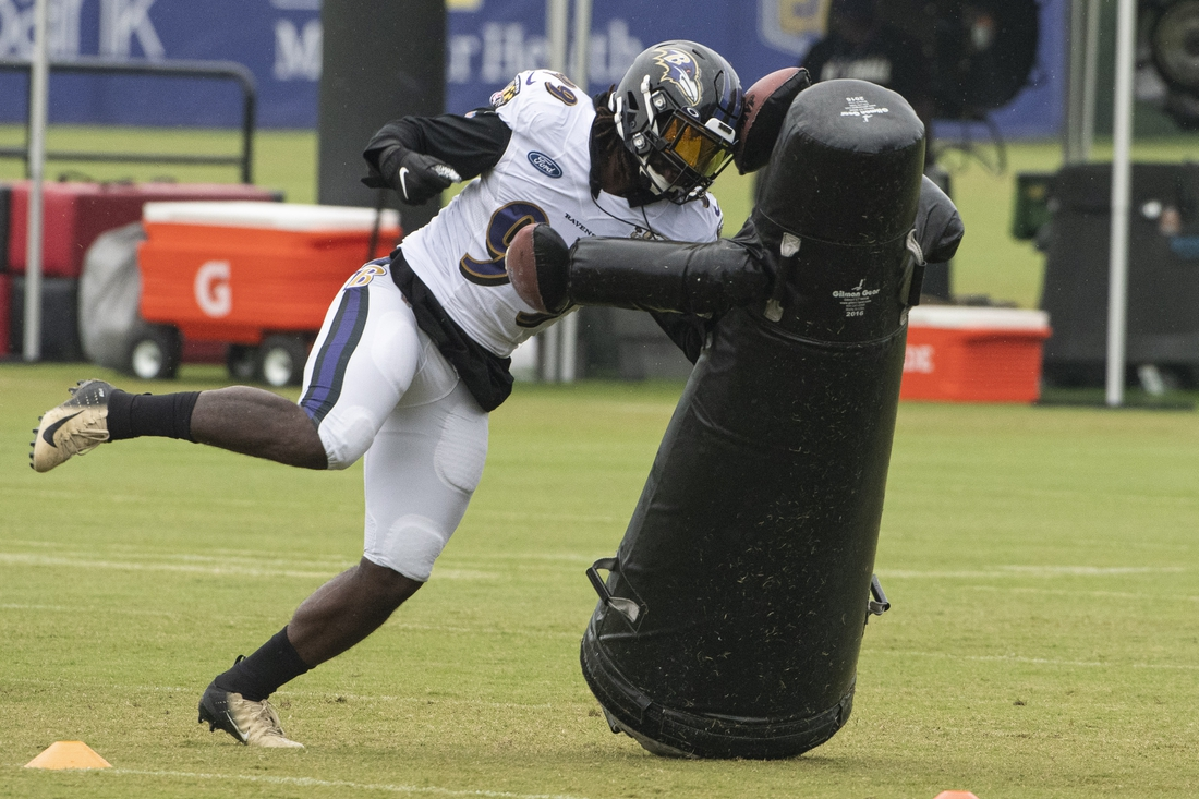 Aug 19, 2020; Owings Mills, Maryland, USA; Baltimore Ravens linebacker Matthew Judon (99) rushes the during positional drills in morning session of training camp at Under Armour Performance Center. Mandatory Credit: Tommy Gilligan-USA TODAY Sports