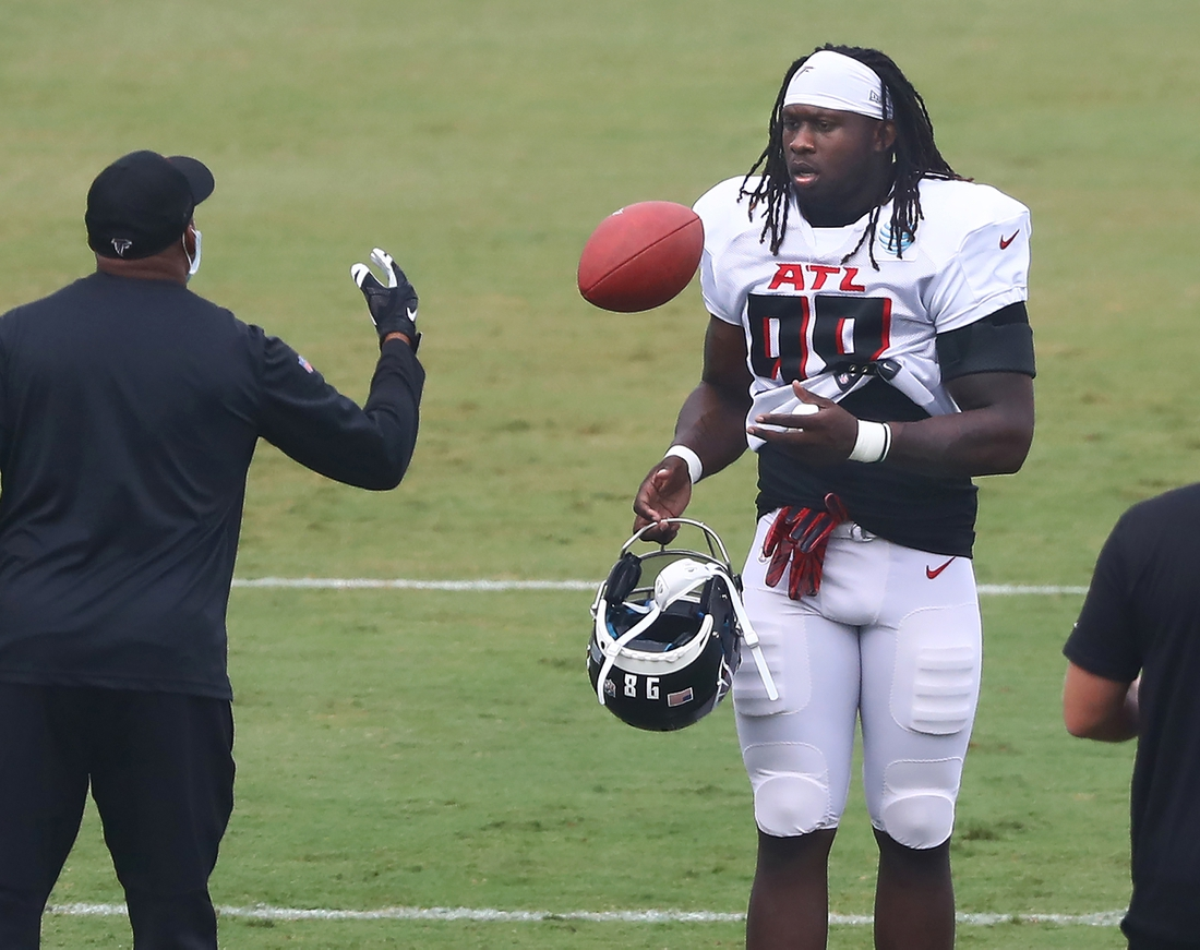 Aug 22, 2020; Flowery Branch, Georgia, USA; Atlanta Falcons defensive end Takk McKinley takes the field and a football for training camp at the Falcons training facility. Mandatory Credit: Curtis Compton/Pool Photo-USA TODAY Sports