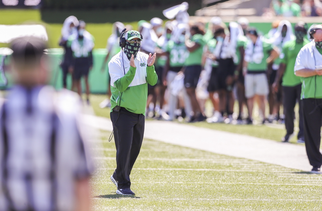 Sep 5, 2020; Huntington, West Virginia, USA; Marshall Thundering Herd head coach Doc Holliday celebrates after his team scored a touchdown during the first quarter against the Eastern Kentucky Colonels at Joan C. Edwards Stadium. Mandatory Credit: Ben Queen-USA TODAY Sports