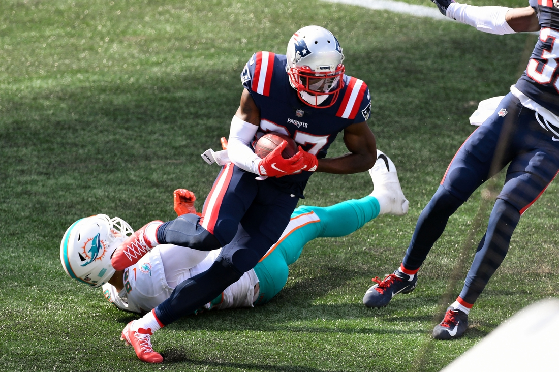 Sep 13, 2020; Foxborough, Massachusetts, USA; New England Patriots defensive back J.C. Jackson (27) intercepts a pass intended for Miami Dolphins tight end Mike Gesicki (88) during the second half at Gillette Stadium. Mandatory Credit: Brian Fluharty-USA TODAY Sports